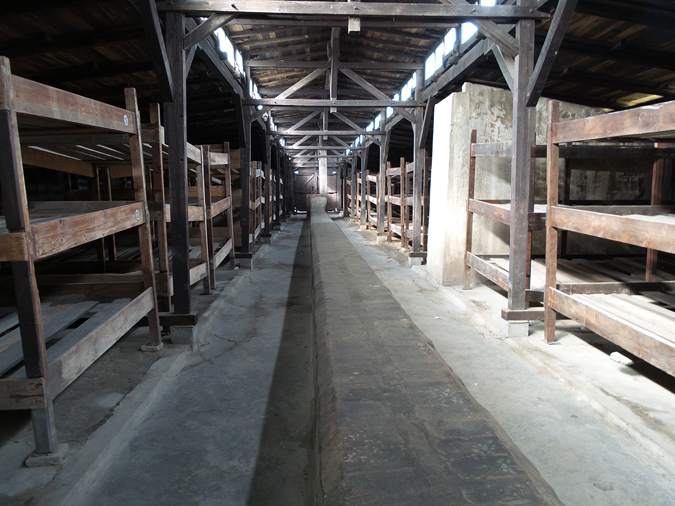 Inside a reproduction of a wooden barracks at Birkenau