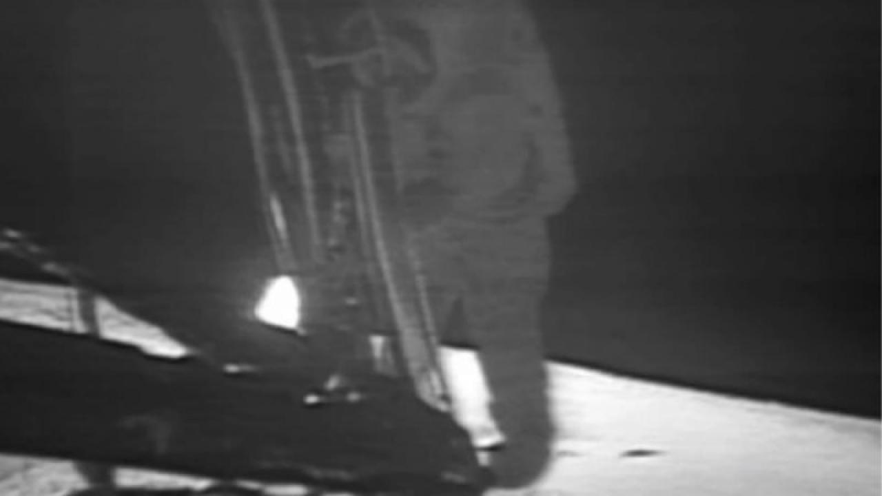 Neil Armstrong steps on the moon